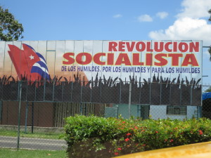 Sign reads Socialist Revolution by and for the Downtrodden
