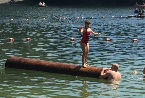 Balancing on the log in the lake at Mohonk